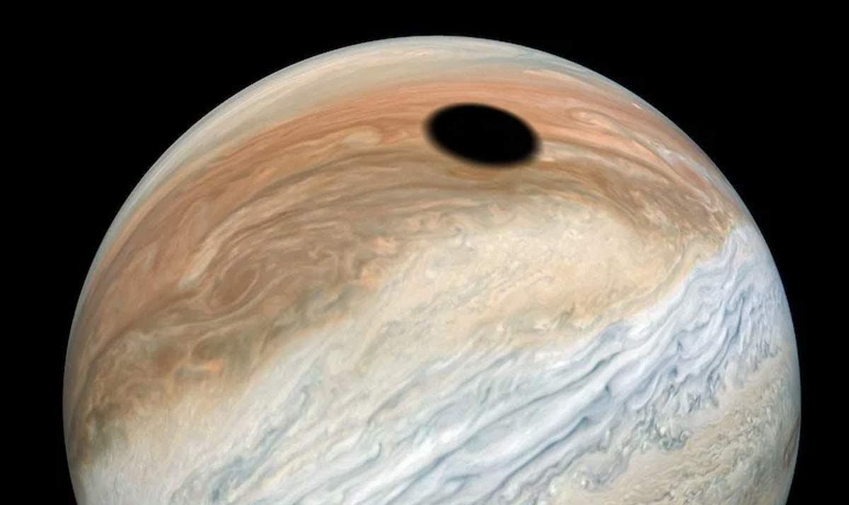 Mysterious black spot on Earth-sized Jupiter seen by NASA spacecraft - and it's actually an eclipse caused by the fiery 'volcano moon'